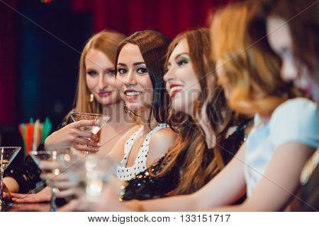 Beautiful girls having fun at a party in nightclub