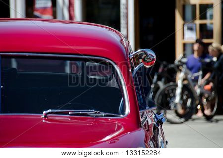 Elements of a red classic car in a town on Kitsap peninsula Washington