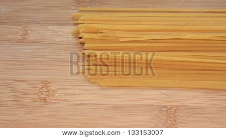 Spaghetti pasta on a wooden kitchen table