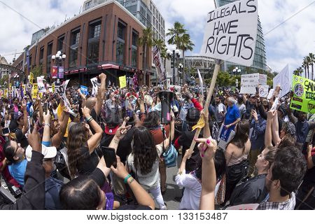 SAN DIEGO USA - MAY 27 2016: The Trump rally in San Diego attracts a huge opposition crowd that gathers in front of the convention center in an emotionally charged protest to stop Donald Trump.
