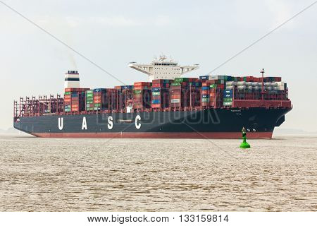 Stade, Germany - May 23, 2016: Ultra large container ship Barzan on the Elbe river. It is the first of a series of six 18,800 TEU container ships built for United Arab Shipping Company in South Korea.