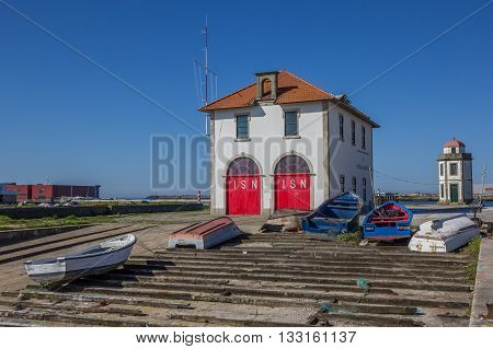 VIANA DO CASTELO, PORTUGAL - APRIL 25, 2016: Little fishing boats in the harbor of Viana do Castelo, Portugal