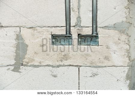 Electrical junction boxes with conduit pipe connection embedded in the wall. Junction boxes for switch. poster