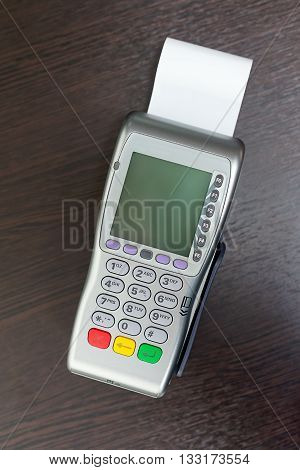 Modern bank terminal on the table. Payment
