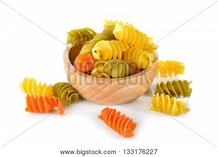 Large Vegerino Rotini spirals pasta in wooden bowl on white background
