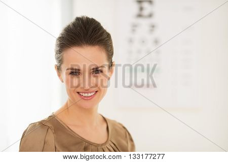 Happy Young Woman In Front Of Snellen Chart