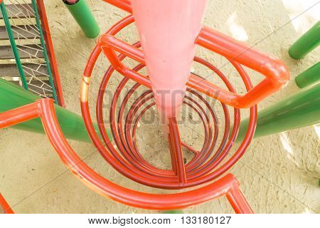 the red climbing frame at a playground