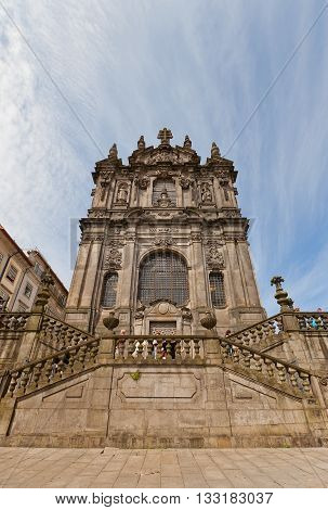 PORTO PORTUGAL - MAY 26 2016: Facade of Clerigos Church in center of Porto (UNESCO site). Was built for Brotherhood of Clerigos (Clergy) by Nicolau Nasoni an Italian architect and painter in 1750