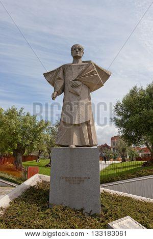 PORTO PORTUGAL - MAY 26 2016: Statue of Antonio Ferreira Gomes (1979 architect Arlindo Rocha) in Porto (UNESCO site). Gomes (1905-1989) was bishop of Portalegre (1949-1952) and of Porto (1952-1982)
