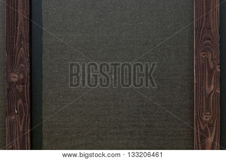 Wood and black paper wall in interior in loft style. Wood plank.Black paper. Wooden frame and black paper. Wood background. Wood table. Black paper and wood.Old wood background.