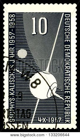 STAVROPOL RUSSIA - APRIL 30 2016: a stamp printed in GDR shows first Sputnik circa 1957