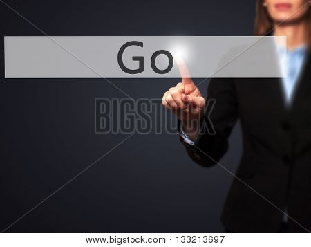 Go - Businesswoman Hand Pressing Button On Touch Screen Interface.