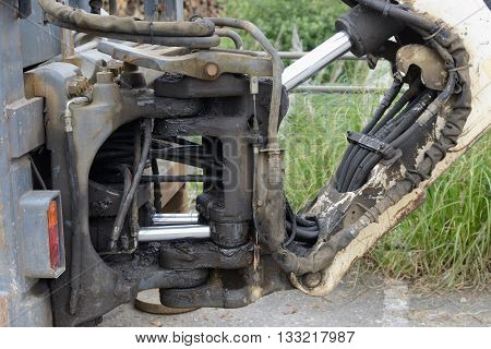 hydraulic connection of the bucket of the excavator close up