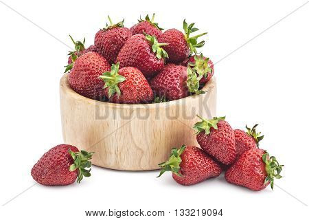Fresh raw organic strawberries in wooden bowl on a white background