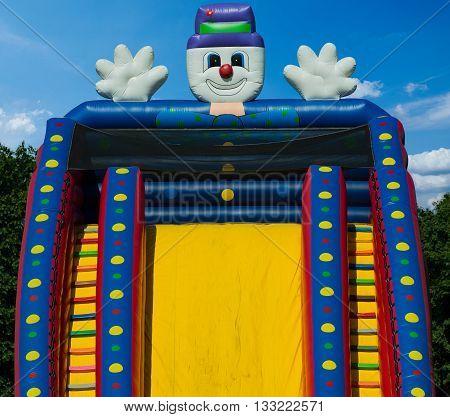 Children's bouncy castle detail against a summer's clear deep blue sky