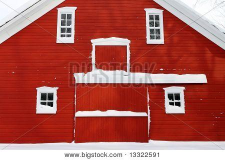 red barn facade in white snow