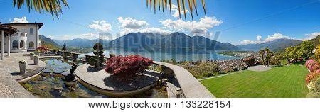beautiful terrace with ornamental garden of a villa, lake view