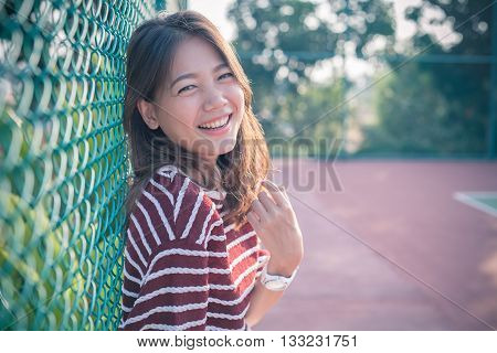smiling face happiness emotion of asian younger woman with no make up face