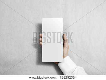 Hand holding blank white flyer brochure booklet in the hand. Leaflet presentation. Pamphlet hold hand. Man show clear offset paper. Sheet template. Booklet design paper sheet display read first person