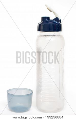 Plastic reusable water bottle isolated on white background