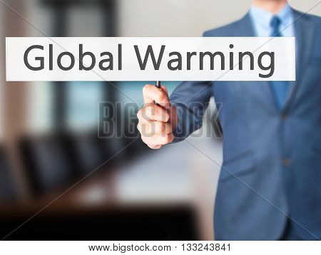 Global Warming - Businessman Hand Holding Sign
