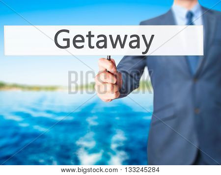 Getaway - Businessman Hand Holding Sign