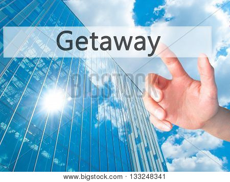 Getaway - Hand Pressing A Button On Blurred Background Concept On Visual Screen.