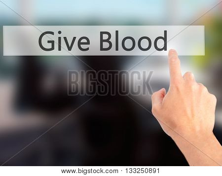 Give Blood - Hand Pressing A Button On Blurred Background Concept On Visual Screen.