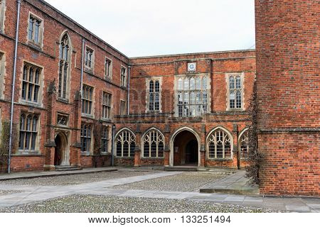 WINCHESTER, UK - FEBRUARY 07, 2016: Great courtyard with college buildings at Winchester College. February 07, 2016 in Winchester, UK.