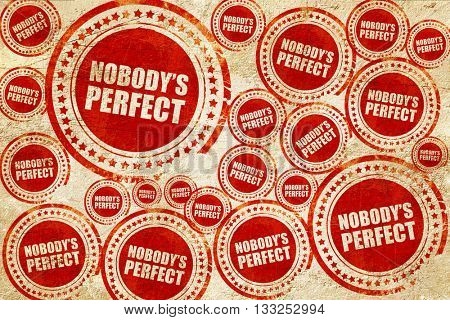 nobody's perfect, red stamp on a grunge paper texture