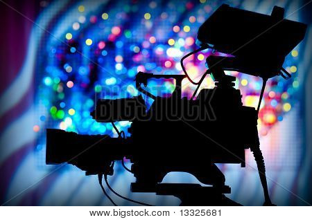 silhouette of a professional television camera on tripod poster