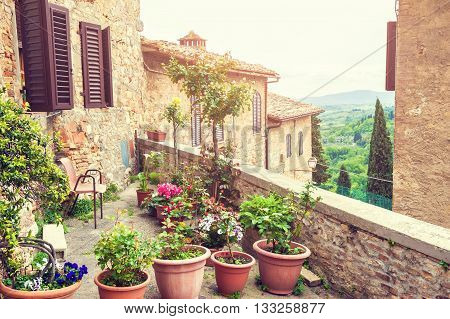 Terrace With Flowers In An Ancient Italian House.