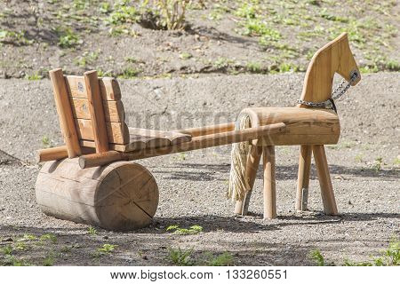 Summer sled made of wood for kids on backyard