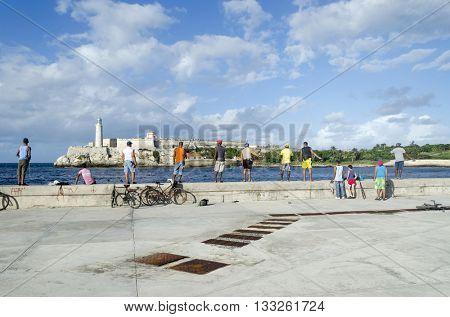 HAVANA - NOVEMBER 28: Cubans fishermens are fishing in the Malecon quay on 28 November 2015 in Havana, Cuba.