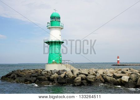 green and red breakwater lights at harbor entrance in Rostock Warnemunde, Germany