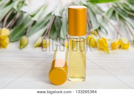 Two Face Serum Bottles On Wooden Table