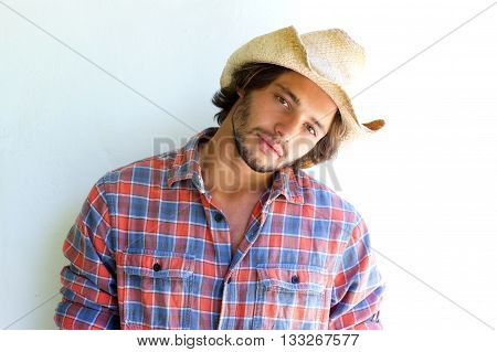 Rugged Young Man With Plaid Shirt And Cowboy Hat