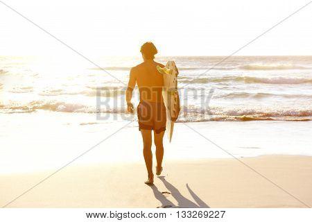 Male Surfer Walking Into Water