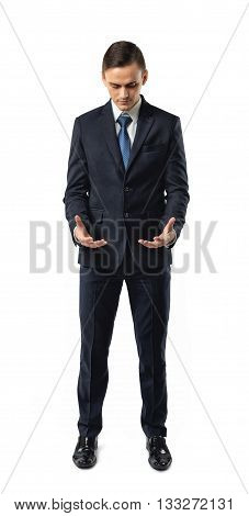 Businessman holding something in his hands and showing its shape. Cut-out image. Palm up. Successful lifestyle. Business staff. Office clothes. Dress code. Presentable appearance. Self-confidence. Ownership. Great fortune.