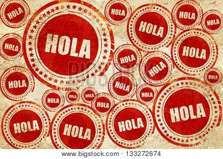 hola, red stamp on a grunge paper texture