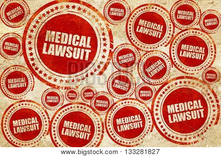 medical lawsuit, red stamp on a grunge paper texture