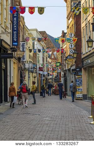 UTRECHT, NETHERLANDS - MAY 6, 2013: It's an old pedestrian street of Utrecht full of tourists and small shops.