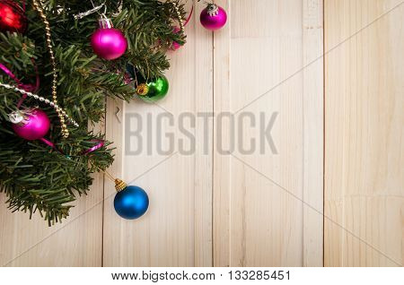 white wooden background with the decor Christmas tree with the New Year decorations