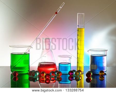 Laboratory glassware still life with colorful reactives