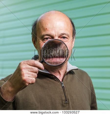Elderly Ranger Incorrectly Uses A Magnifying Glass Because Of Forgetfulness. The Increase In The Tee