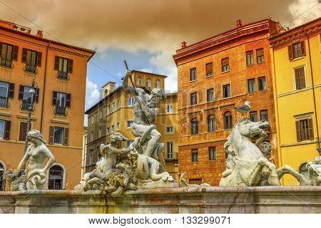 Fontana del Nettuno, fountain of Neptune, in colorful Piazza Navona, Roma, Italy