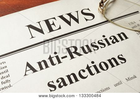 Newspaper with word news and Anti-Russian sanctions.