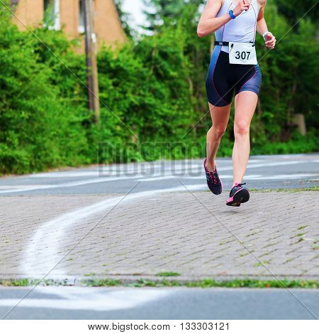 unrecognizable female runner at a foot race