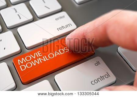 Man Finger Pushing Movie Downloads Orange Button on Modern Keyboard. Hand using White Keyboard with Movie Downloads Orange Keypad, Finger, Laptop. 3D.