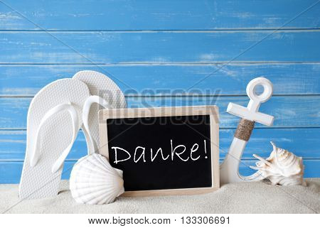 Chalkboard With German Text Danke Means Thank You. Blue Wooden Background. Summer Card With Holiday Greetings. Beach Vacation Symbolized By Sand, Flip Flops, Anchor And Shell.